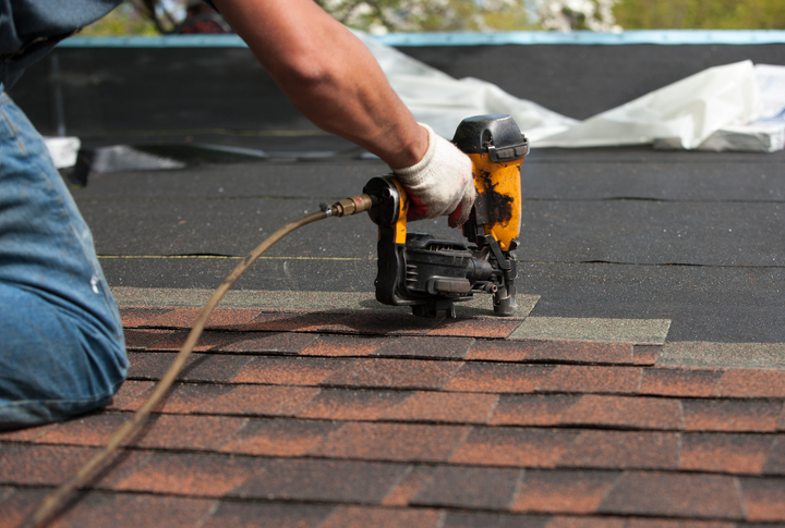 Roofer Installing New Roof Shingles